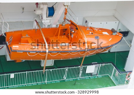View of modern safety lifeboat carried by a cruise ship for use in emergency evacuation #328929998