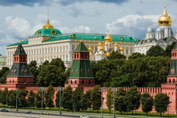 View of Moscow on a summer day. capital of Russia. Grand Kremlin palace. Church Of The Kremlin. Kremlin embankment. river Moscow. Popular tourist attraction. Business card of Moscow.