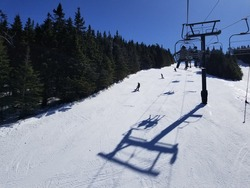 View of Mount Snow Ski Resort from Chairlift during Spring Conditions.