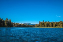 View of Mountains and Pine Trees from Lake Cascade in Donnelly, Idaho