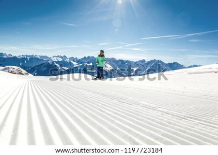 View of mountains and ski slopes in Austria #1197723184