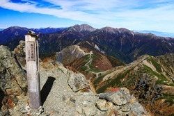 view of Mountains in the northern part of the Southern Alps from the summit of mt.shiomi,ina city,nagano prefecture,japan. I translate the  japanese written on the sign: Mt.shiomi,east peak 3052m