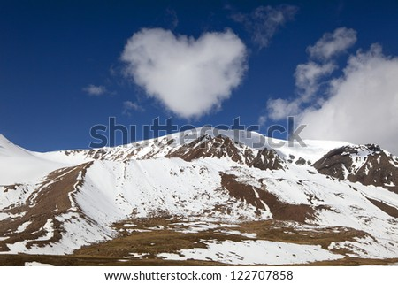 view of mountains with cloud like a heart in shape