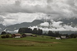 View of Mt. Watzmann in the Berchtesgaden Alps on an overcast day in summer in Bischofswiesen, Germany. Alpine mountain landscape with strong clouds.