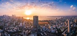 View of Mumbai showing the Bandra Worli Sea Link in the centre passing over the Mahim Bay, with the city around it. Dadar, Prabhadevi, Lower Parel, Worli, Matunga, Mahim and Bandra can be seen.