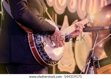 View of musician playing banjo in concert at night. Movement. Shallow depth of field. - Shutterstock ID 544319575