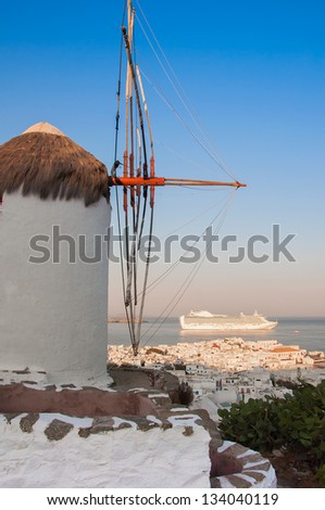 view of Mykonos, windmill and old port with cruise ship