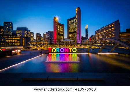 View of Nathan Phillips Square and Toronto Sign in downtown at night, in Toronto, Ontario.