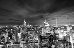 View of New York night with cloudy sky.