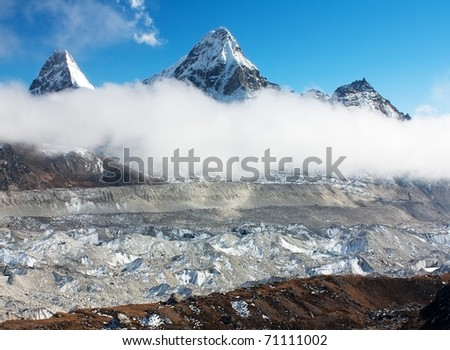 view of Ngozumba glacier with clouds and cholo peak and Kangchung Peak - Nepal