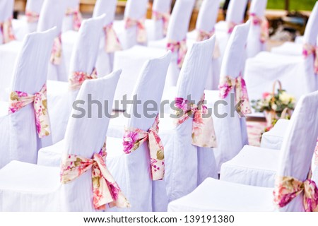 view of nice chairs ready for wedding ceremony