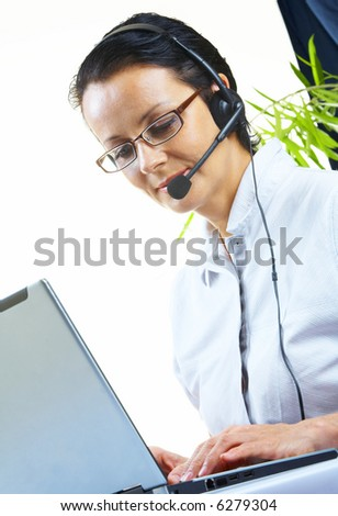 view of nice operator in stylish glasses at her working place
