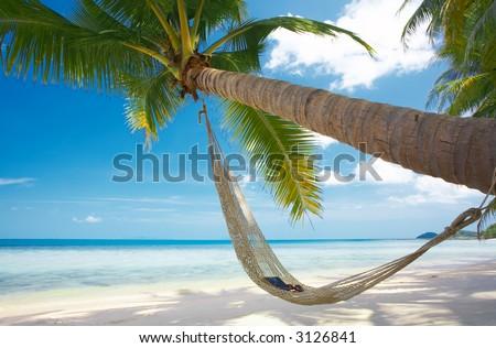 view of nice straw hammock on the tropic beach - stock photo