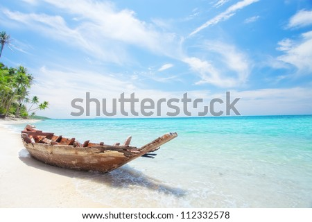 View of nice tropical  beach  with old boat