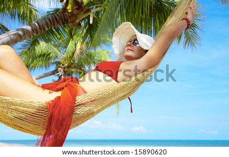 view of nice woman lounging in hammock in tropical environment #15890620