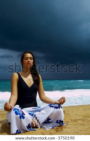 view of nice young woman practicing yoga on stormy beach