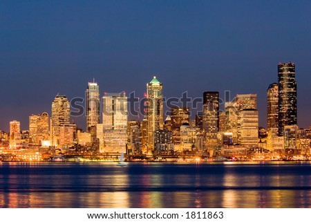 View of nighttime Seattle across Puget Sound