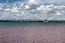 View of north side of the bridge over the lake. JK Bridge. Brasília,  capital of Brazil. Cityscape. Clouds in the sky.