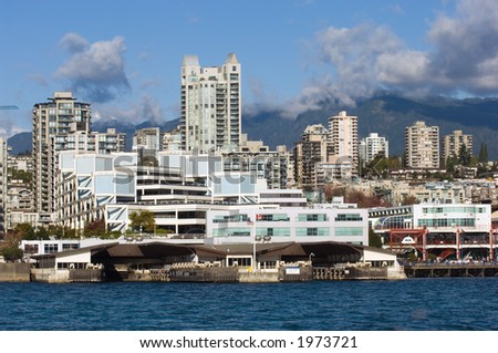 View of North Vancouver and mountains from seabus in bright day - stock photo
