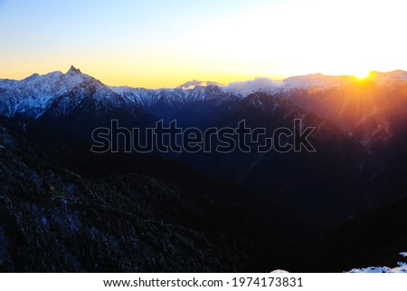 View of northern alps(mt.yari and mt.kasa) from the summit of Mt.Tsubakuro in sunset, northern alps,Nagano prefecture, Japan Zdjęcia stock ©