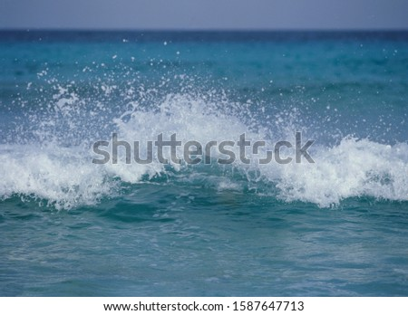 View of ocean waves breaking