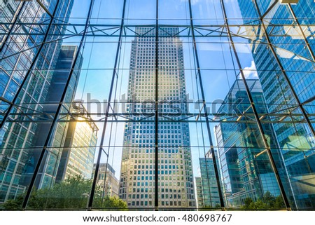 View of office buildings through glass window in Canary Wharf, financial district of London #480698767