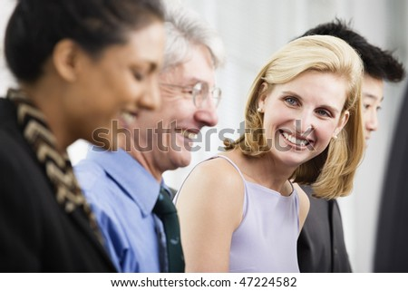 View of office executives smiling. - stock photo