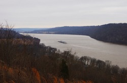 View of Ohio river Valley from hills of southern Indiana with Kentucky in background and barge on river