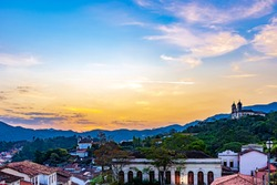 View of old houses and churches in colonial architecture from the 18th century at sunset in the historic city of Ouro Preto in Minas Gerais, Brazil