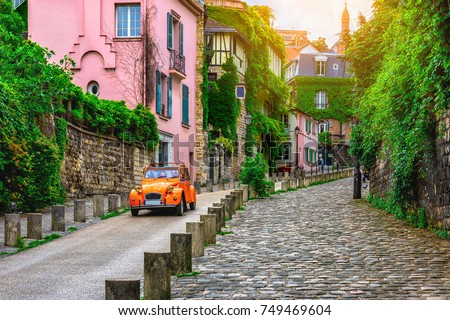 Photo of View of old street in quarter Montmartre in Paris, France. Cozy cityscape of Paris. Architecture and landmarks of Paris.