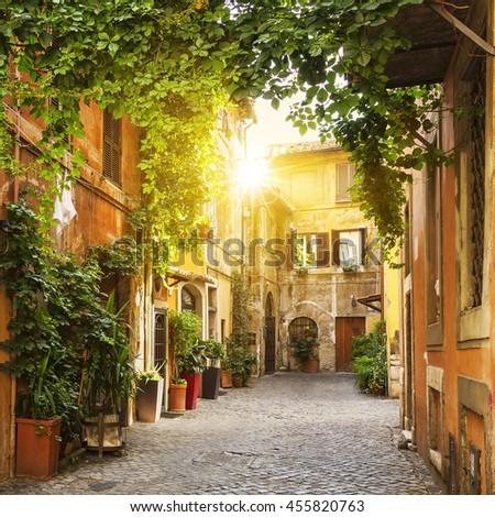 stock photo view of old street in trastevere in rome italy 455820763 - Каталог — Фотообои «Улицы, переулки»