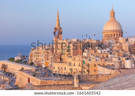 View of Old town roofs, fortress, Our Lady of Mount Carmel church and St. Paul's Anglican Pro-Cathedral at sunset , Valletta, Capital city of Malta Stock photo ©
