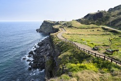 View of Olle No. 10 Course in Songaksan in jeju island, Korea. Olle is famous trekking courses created along coast of Jeju Island. Songaksan is famous place for drama