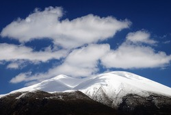 View of Olympos mountain covered with snow, taken from the village Olympiada. Municipality of Elassona, Larissa prefecture, Thessaly region, Greece.