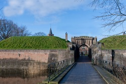 View of one of the entrance gates of the fortified town of Naarden, The Netherlands; one of the best preserved fortified towns in Europe and famous for its unique star shape