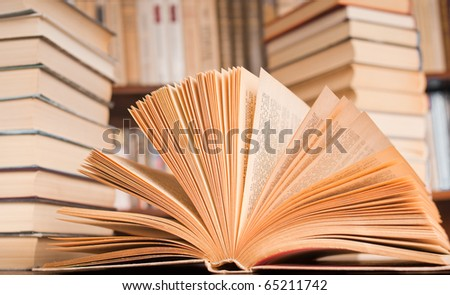 View of opened book isolated on white background