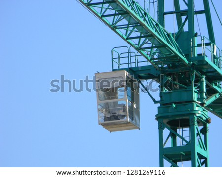 View of operator's cabin and slewing unit of a tower crane, Tirana, Albania