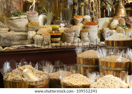View of oriental Arabic spices put on wooden barrels on spice market.