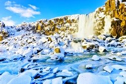 View of Oxararfoss waterfall in winter at Thingvellir National Park in Iceland.