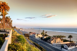 View of Pacific Coast Highway at Santa Monica beach, ocean front homes as seen from Palisades park, in southern California.