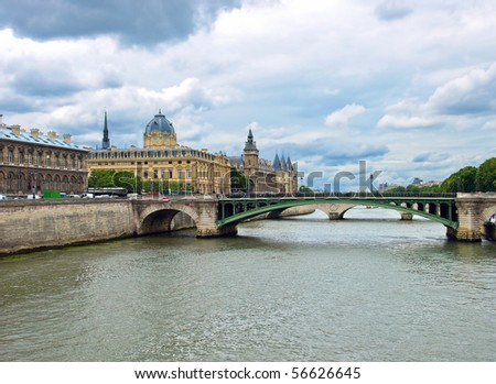 View of Palais de Justice and a bridge over the Seine river. Paris, France. Clipping Path.