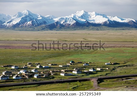 view of Pamir range, alay valley and Sary Tash village in Kyrgyzstan