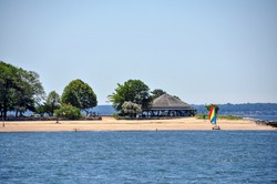 View of part of Island Beach with pavilion, located two miles south of Greenwich Harbor, Greenwich, which can be reached by ferry for recreational purposes