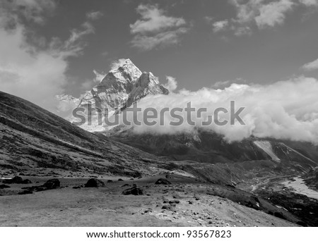 View of peak Ama Dablam and village Periche (black and white) - Mt. Everest region, Nepal - stock photo