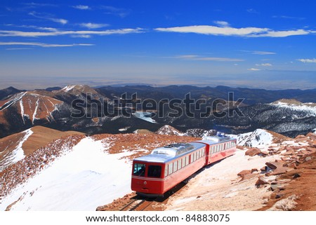 View of Pikes Peak and Manitou Springs Train on the top of Pikes Peak Mountain, Colorado, USA - stock photo
