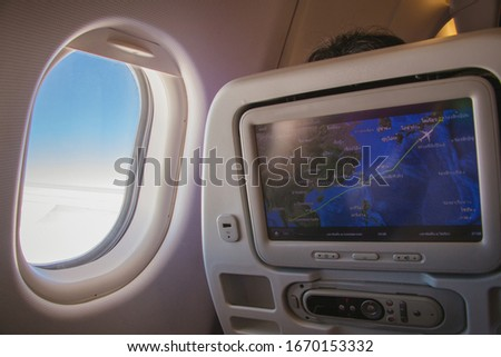 View of plane's cabin windows seat with beautiful scenic view and screen monitor show map destination landing to Tokyo. Seat airplane and window view inside an aircraft. Monitor & window on plane. ストックフォト ©