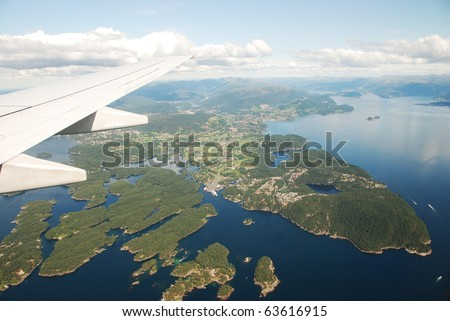 View of plane window, fjords, Norway