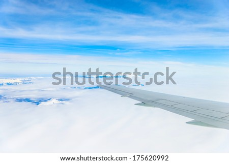view of planet earth from an airplane through the window