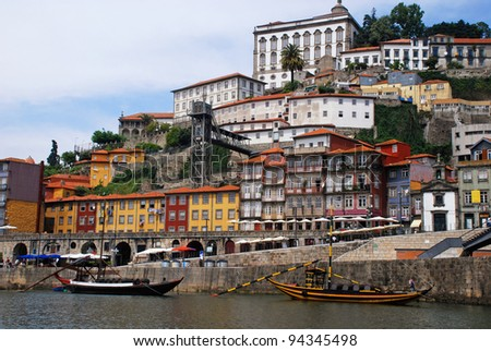 "View of Porto city at the riverbank (Ribeira quarter) and wine boats(""Rabelo"") on River Douro(Portugal), a UNESCO World Heritage City."