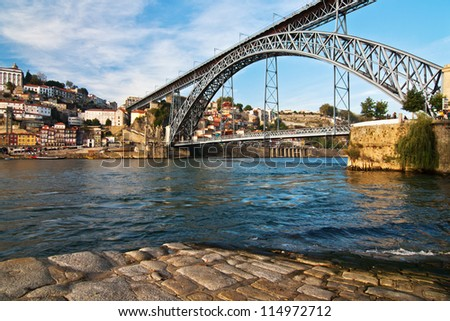 view of Porto in Portugal with the famous bridge over the river Douro from the famous architect Eiffel